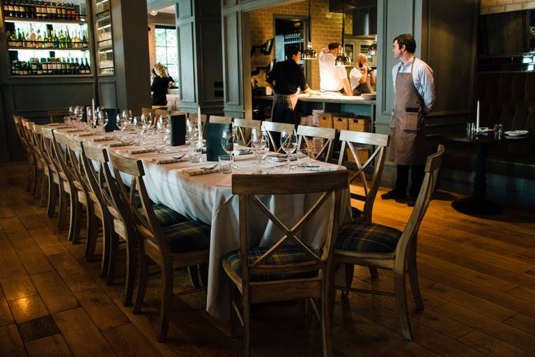 Long dining table with cafe chairs at Beacon Tavern in Chicago, IL | PartySlate