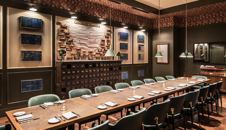 Somerset in Chicago private dining room with long wood table and blue chairs | PartySlate
