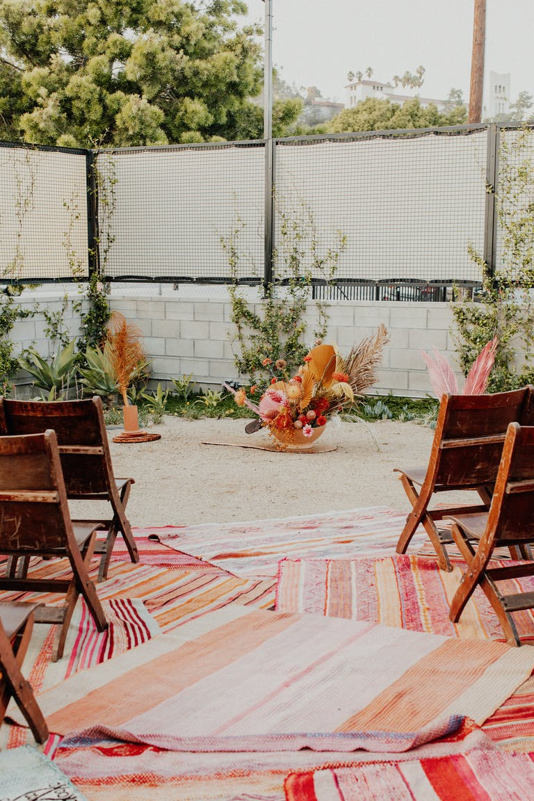 Bohemian Wedding with wedding aisle throw rugs.