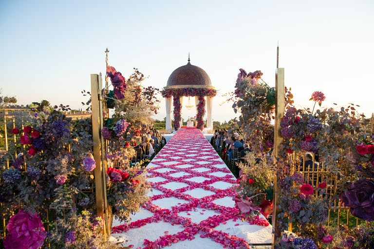 Breathtaking Wedding at Pelican Hill Resort in Newport Beach, CA With Criss-Cross Rose Petal Wedding Aisle Décor.