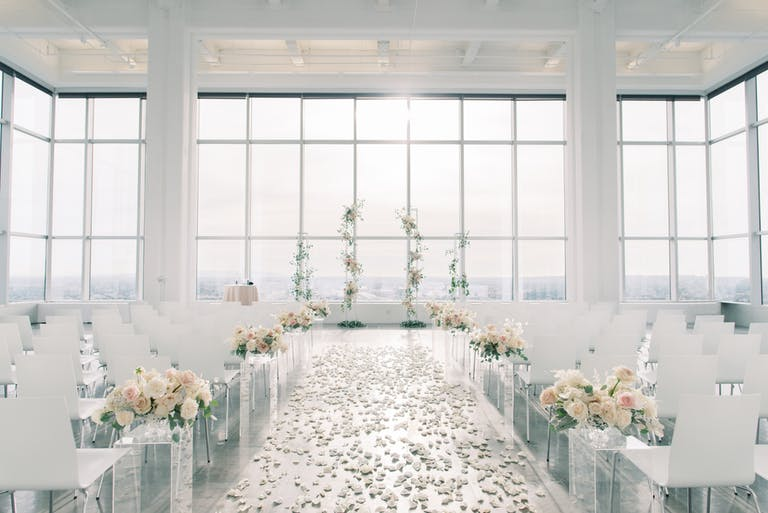 Bright White Wedding at South Park Center in Los Angeles, CA With Monochromatic Wedding Aisle Décor.