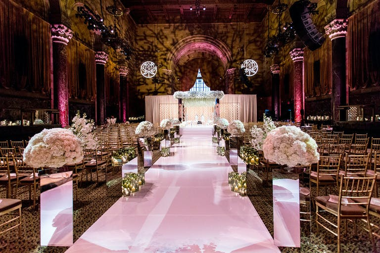 Glamorous wedding at Cipriani with mirrored wedding aisle décor.