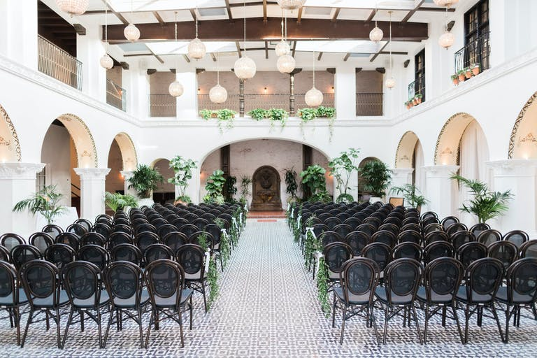 Elegant & Simple Courtyard Wedding With Creative Wedding Aisle Décor