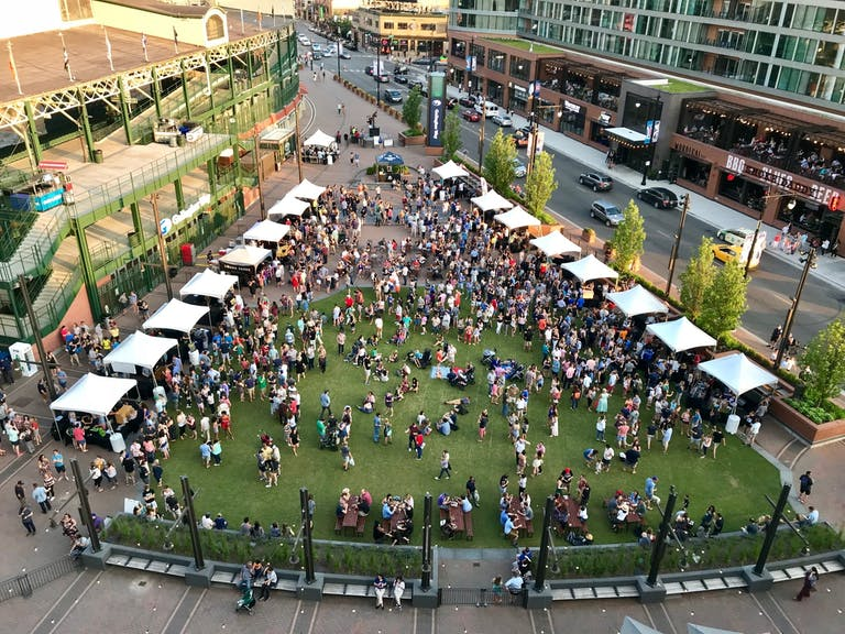 Crowded green plaza next to Wrigley Field, Chicago | PartySlate