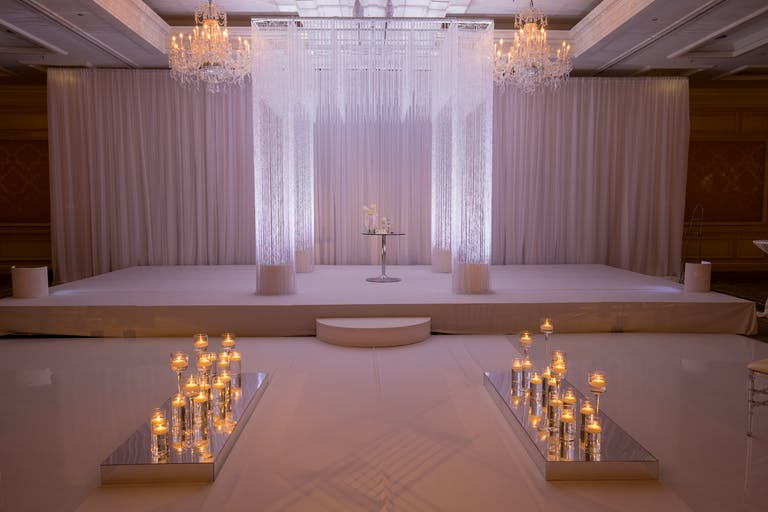 Glamorous All White Wedding at Four Seasons Hotel Chicago in Chicago, IL With Candle-Lit Wedding Aisle Decorations