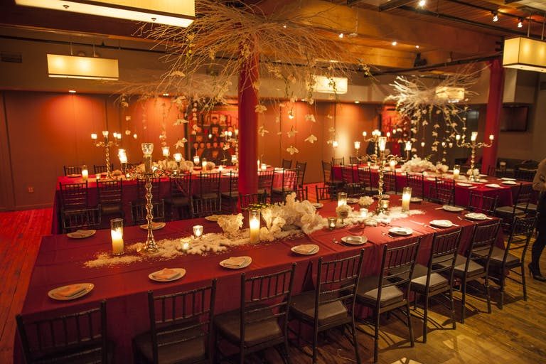 Bright red themed event space with long tables in Chicago | PartySlate