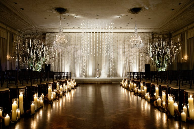 Lush White and Green Wedding With Candle-Lit Wedding Aisle Décor
