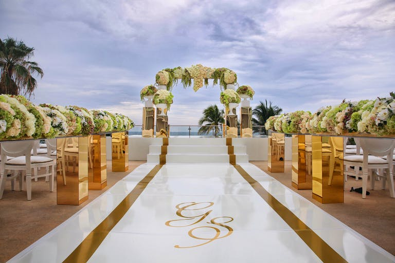 Oceanfront Wedding at Fontainebleau Miami Beach in Miami Beach, FL With Creative Wedding Aisle Décor