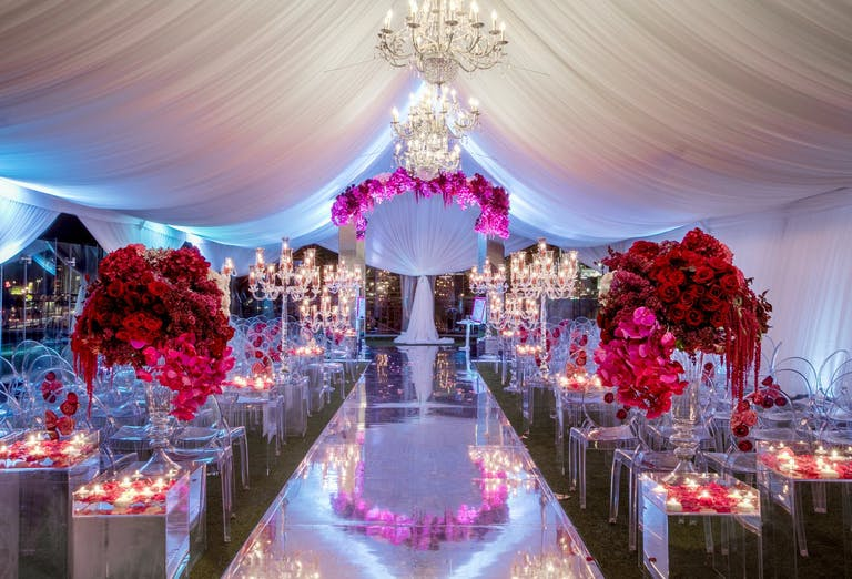 Luxe Wedding with mirrored wedding aisle décorl and floating candles.