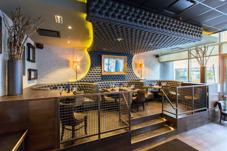 Elevated banquette area with plush gray tufted booths at Siena Tavern in Chicago, IL | PartySlate