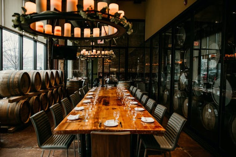 The Private Barrel Room at City Winery Chicago with oak barrels and a long wood table | PartySlate