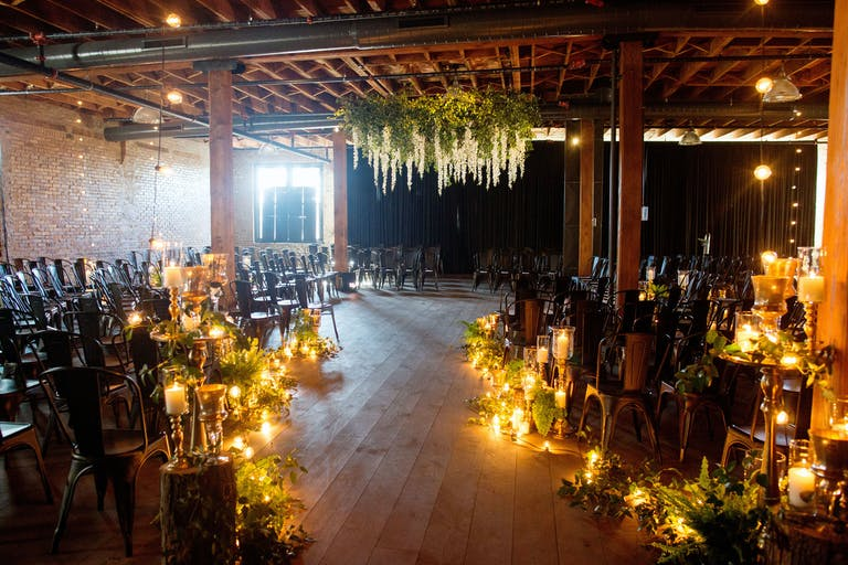 Sophisticated St. Patrick's Day Wedding at Artifact Events in Chicago, IL With Candle-Lit Wedding Aisle Decorations