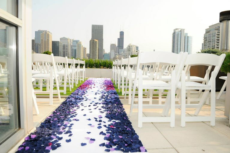 Ombre rose petal wedding aisle décor at surprise rooftop wedding.