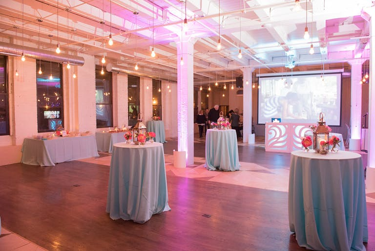 An open event space in Chicago for your sweet sixteen includes high tables for eating around and hanging industrial lights | PartySlate