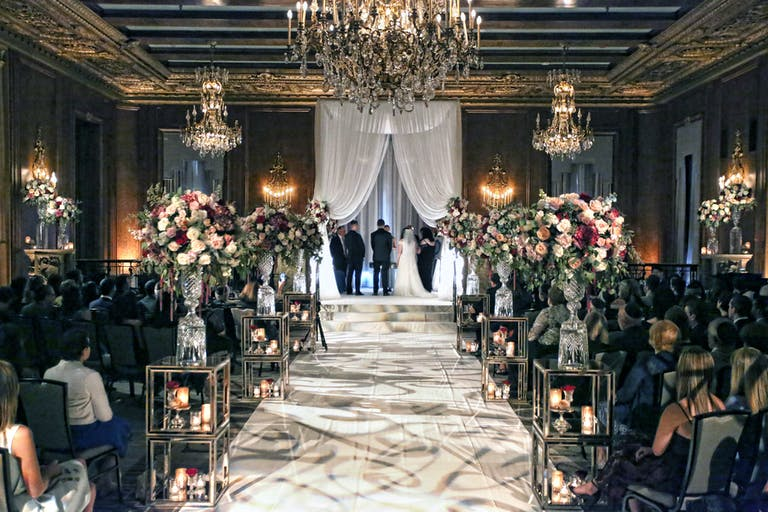 Traditional Historic Wedding at InterContinental Chicago Magnificent Mile in Chicago, IL With Creative Lighting Wedding Aisle Décor