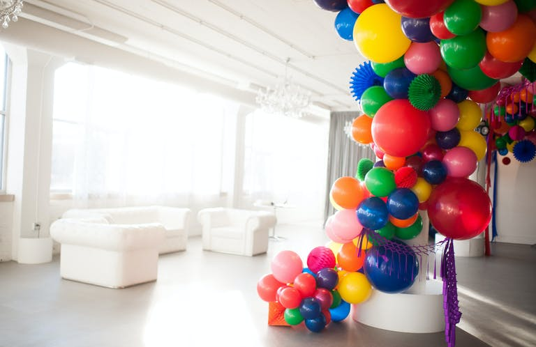 colorful sweet sixteen birthday balloon installation in white room in Chicago | PartySlate