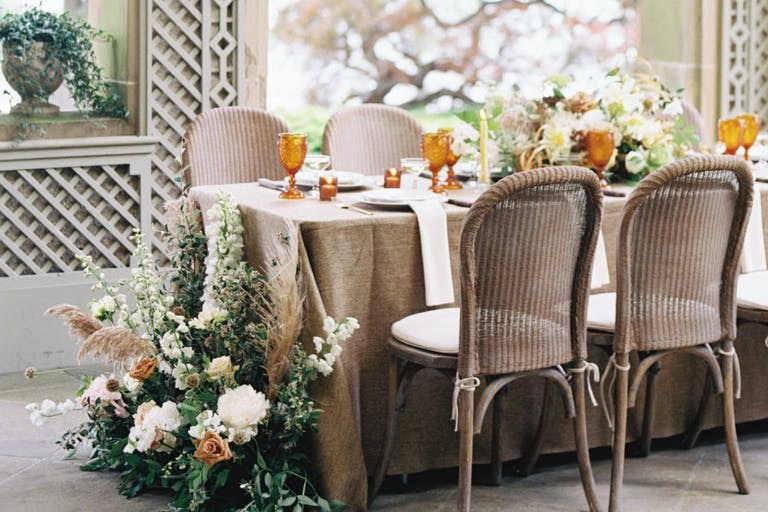 Intimate wedding reception table with florals.