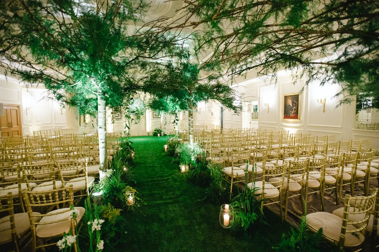 AN ENCHANTED FOREST INSPIRED WEDDING at the Savoy Hotel in London, UK with greenery wedding aisle décor.