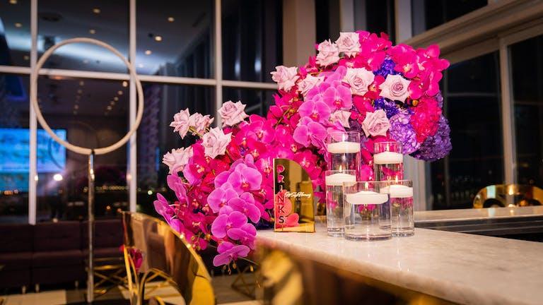 Cirque Du Sophia purple and pink flower arrangement | PartySlate