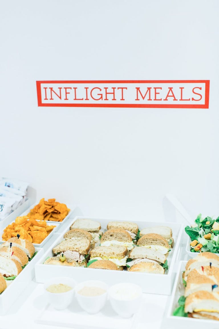 Sandwich display with an inflight meals label | PartySlate