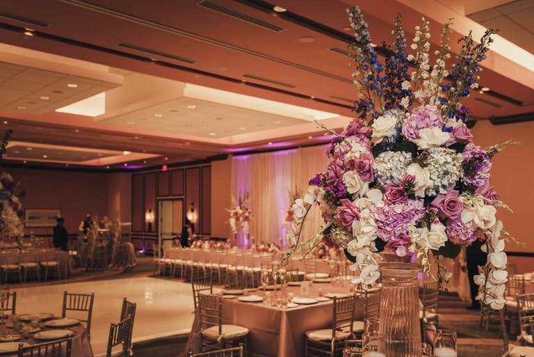 Glam Wedding at PGA National Resort & Spa in Palm Beach Gardens, Florida With Orchid Wedding Centerpieces