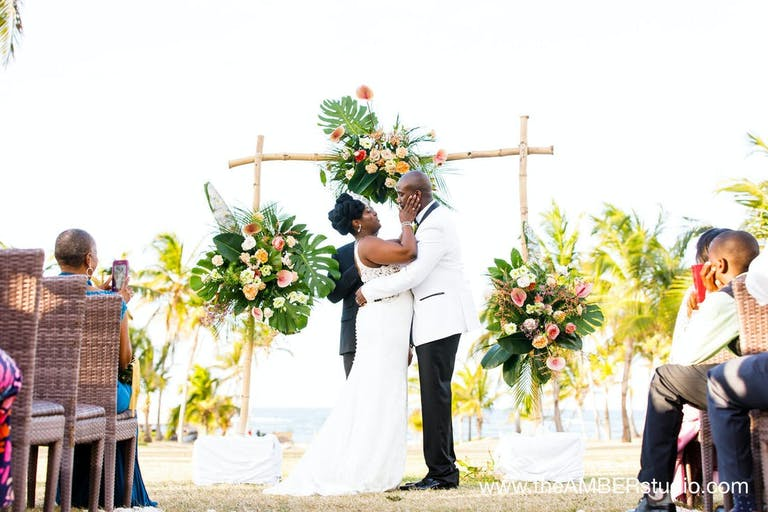 Bride and grooms first kiss | PartySlate