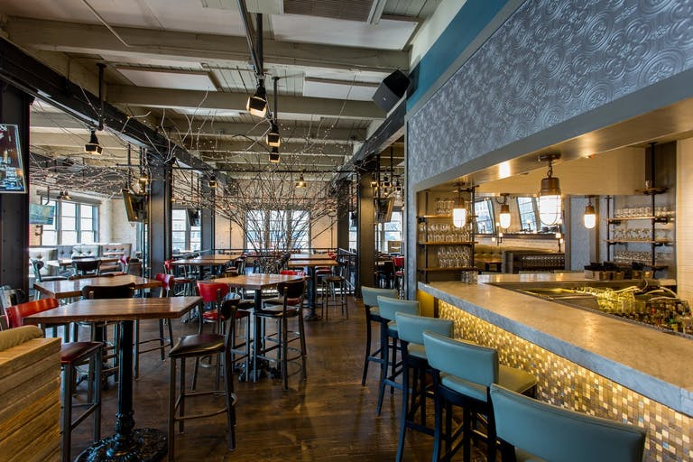 Upper level event space for your sweet sixteen in Chicago with a bar and high tables | PartySlate