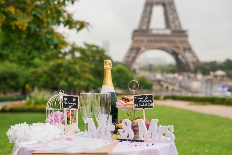 Mr. & Mrs. table with the Eiffel tower in the background | PartySlate