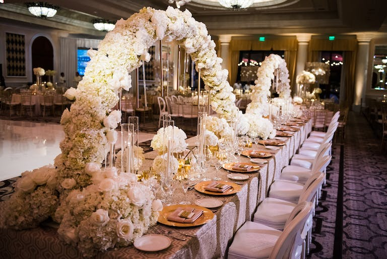 Long Wedding Reception Table with Undulating White Hydrangea Wedding Centerpieces