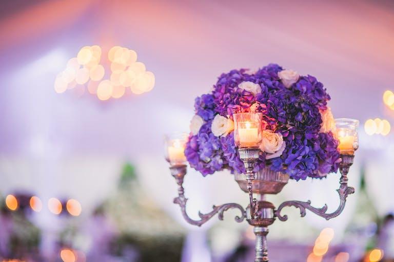 Close Up of Purple Hydrangea Wedding Centerpiece Featuring a Silver Candelabra
