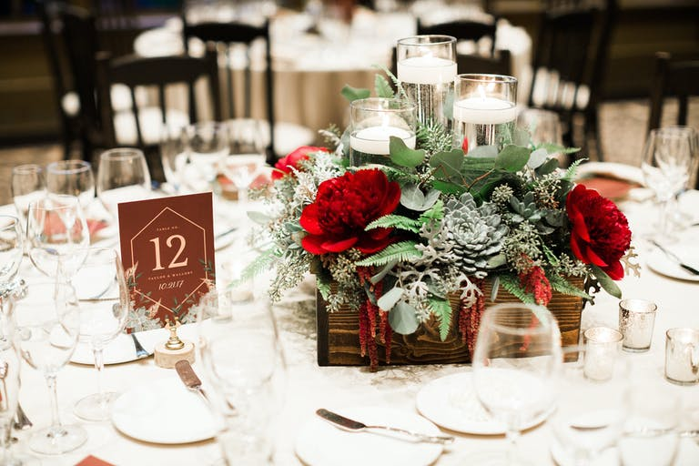 Wedding Centerpiece With Succulents and Red Blooms