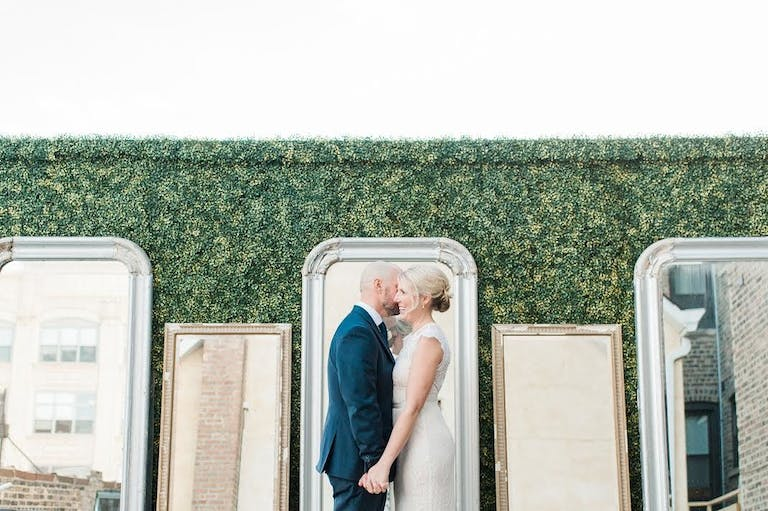 Wedding with Pastel Spring Wedding Colors and Boxwood Backdrop with Vintage Mirrors