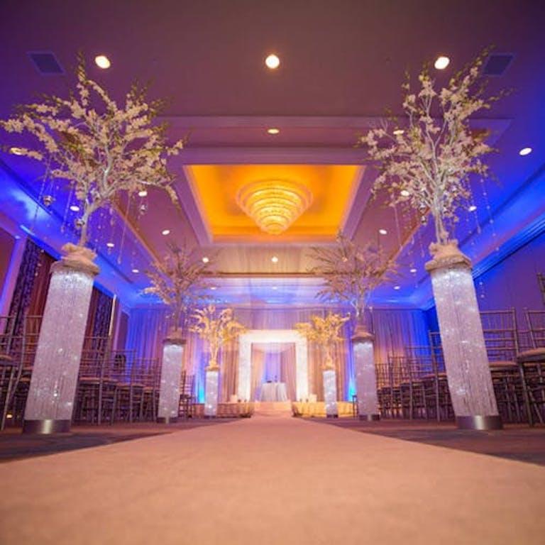Dazzling San Francisco Wedding Venue with large aisle floral arrangements | PartySlate