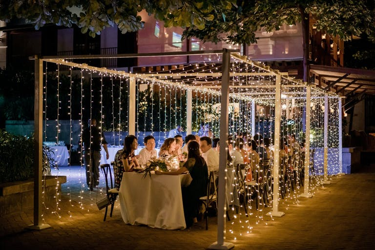 Cascading string lights forming into a small tent 2021 trend | PartySlate