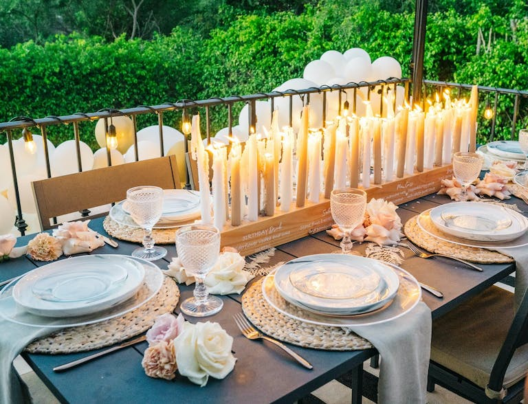 Wooden centerpiece with candles and drink menu engraves 2021 trend | PartySlate