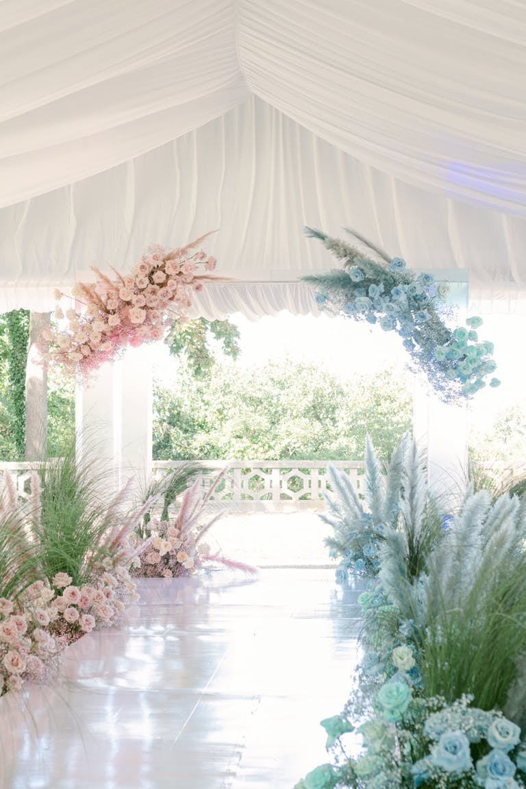 Ballerina pink and baby blue wedding reception florals trends 2021 | PartySlate