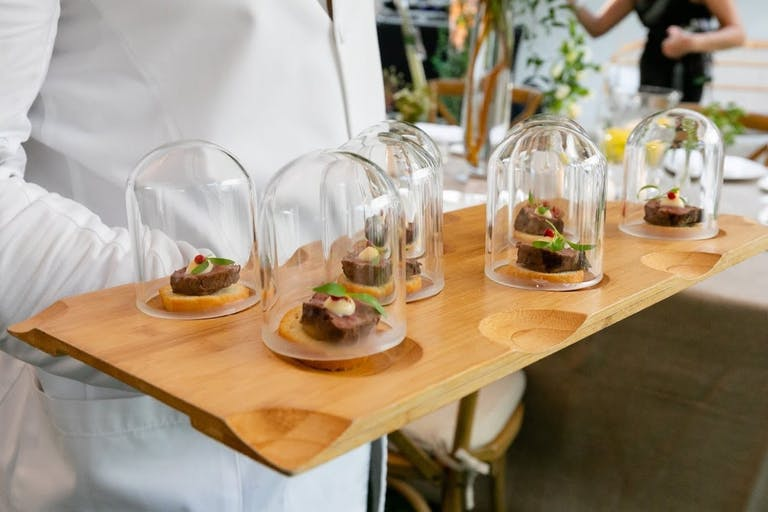 2021 trend glass domes over appetizer tray | PartySlate