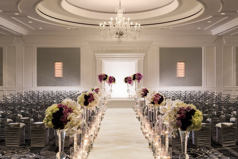 San Francisco Wedding Venue aisle with purple and white floral | PartySlate