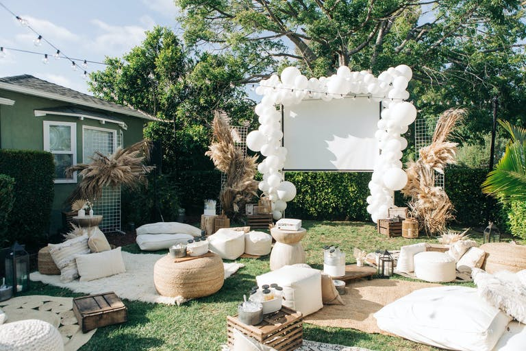 Backyard movie theater with a boho style | PartySlate