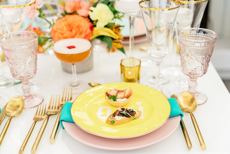 2021 trend eclectic paris theme with yellow plates   PartySlate