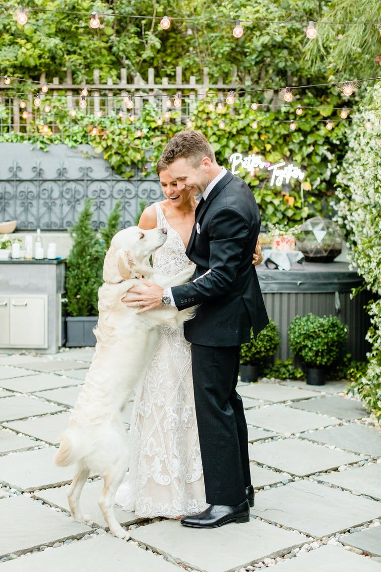 Bride and groom dance and their dog, 2021 trend   PartySlate