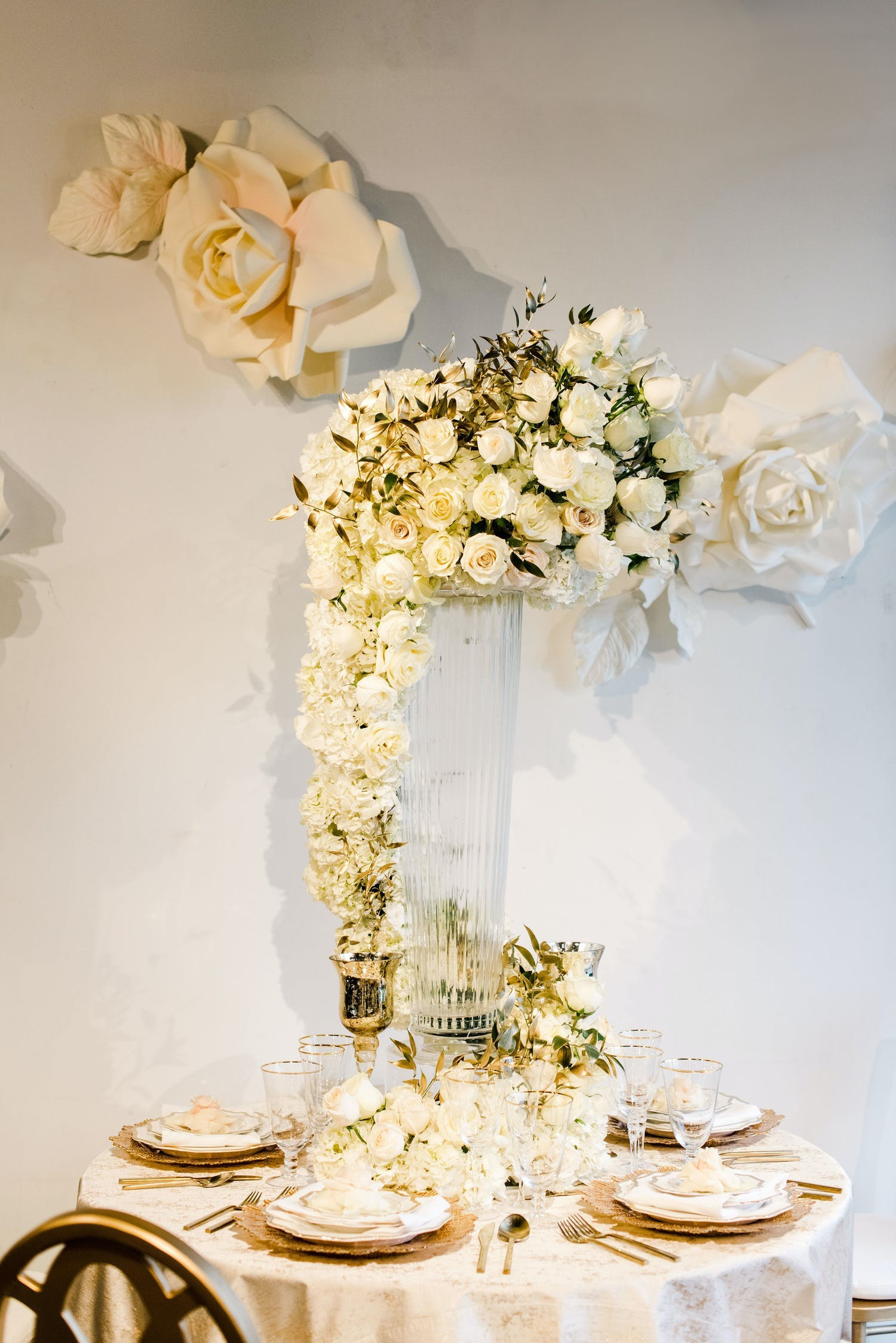 Overflowing white flower bouquet as centerpiece | PartySlate