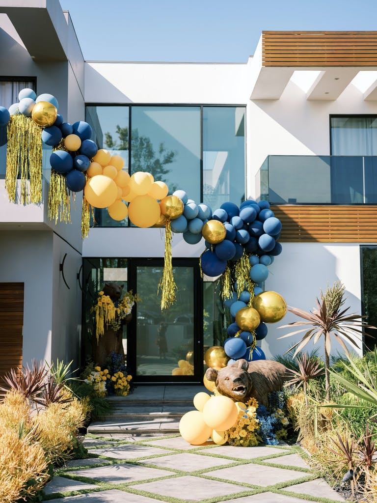 A UC-Berkely themed graduation balloon installation 2021 trend | PartySlate