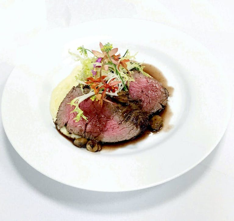 Steak served on a white plate | PartySlate