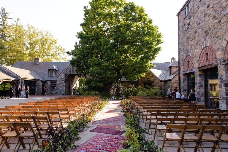 Rolling Stones' Beggar's Banquet Themed Wedding at Blue Hill at Stone Barns in Pocantico Hills, NY With Throw Rug Wedding Aisle Décor