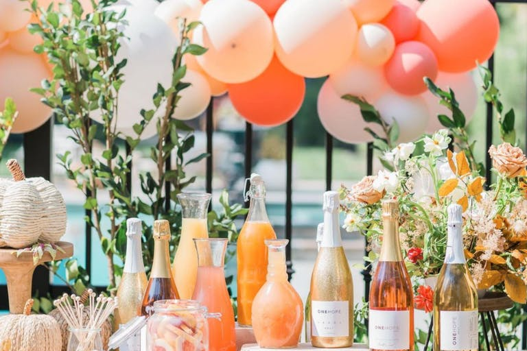 Mimosa Station in Peach Color Palette With Matching Balloon Décor | PartySlate