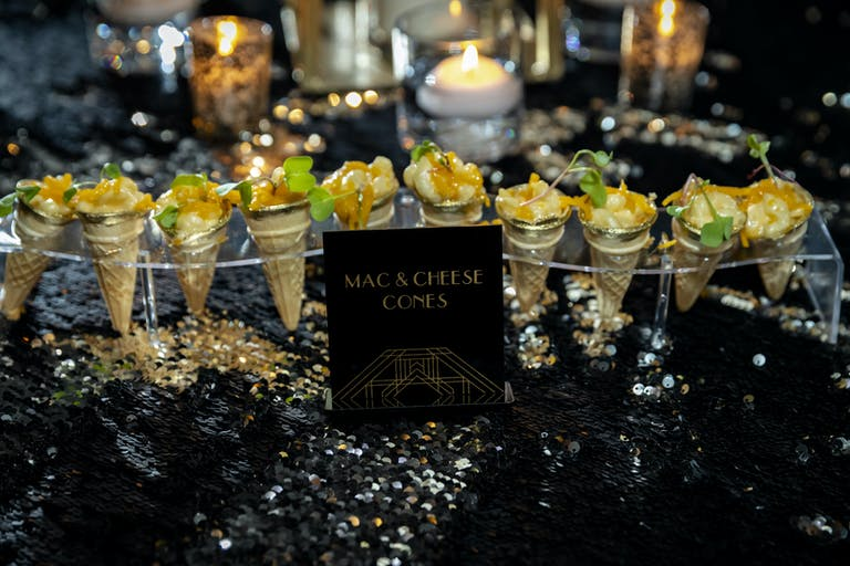 Close Up of Mac & Cheese Cones at Black and Gold Great Gatsby 16th Birthday in Miami, FL | PartySlate