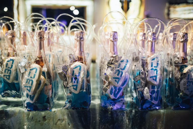 Corporate Anniversary Party With Mini Champagne Party Favors | PartySlate