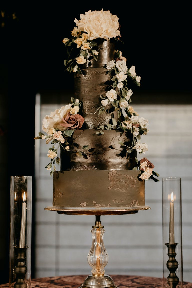 Black Wedding Cake at Luxurious Enchanting Wedding at The Asian Art Museum in San Francisco, CA | PartySlate