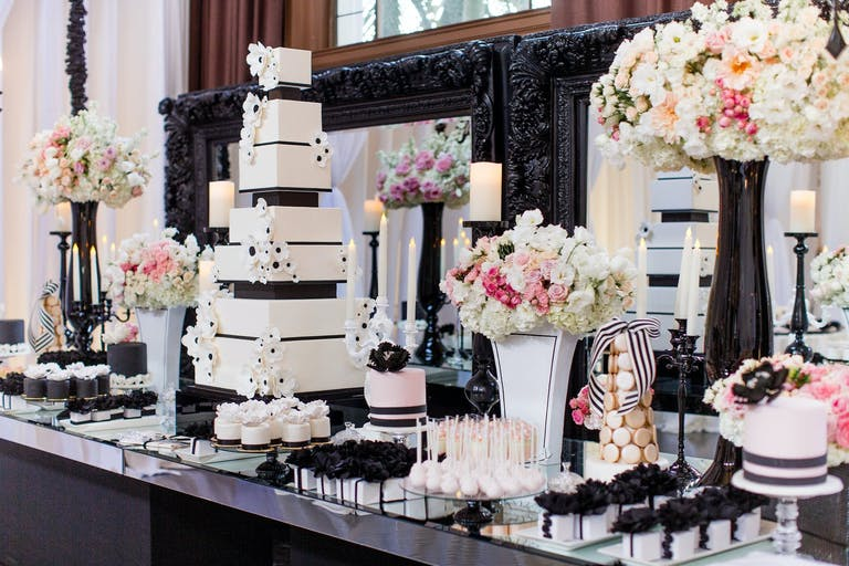 Black and White Wedding Cake and Other Dessert With Pink Floral Décor | PartySlate